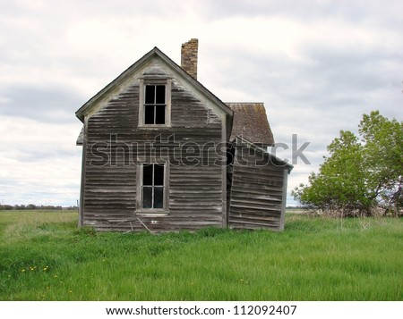 old weathered farm buildings house - stock photo