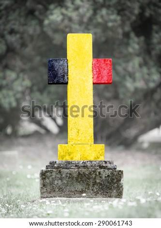 Old weathered gravestone in the cemetery - Belgium - stock photo
