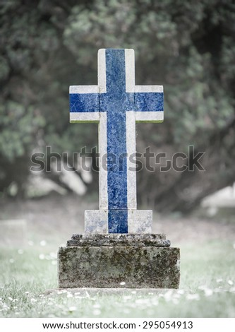 Old weathered gravestone in the cemetery - Finland - stock photo