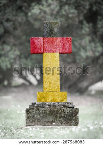 Old weathered gravestone in the cemetery - Germany - stock photo