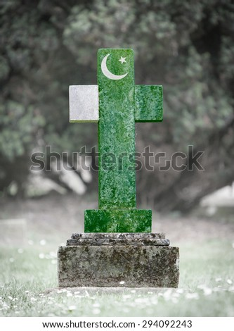 Old weathered gravestone in the cemetery - Pakistan - stock photo