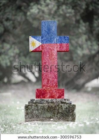 Old weathered gravestone in the cemetery - Philippines - stock photo