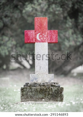 Old weathered gravestone in the cemetery - Singapore - stock photo