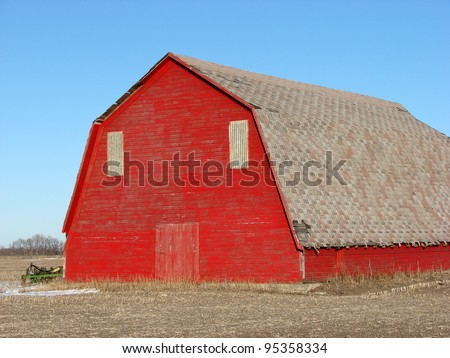 old weathered red farm building barn - stock photo