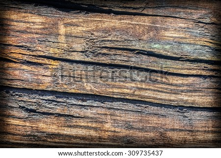Old Weathered, Rotten, Cracked, Square Timber Bollard, Vignette, Grunge Surface Texture Detail. - stock photo