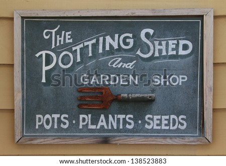 Old weathered sign of a potting shed. - stock photo