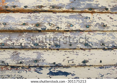Old weathered wood panel with peeling paint  - stock photo