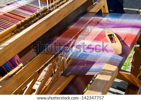 Old weaving loom and shuttle - stock photo
