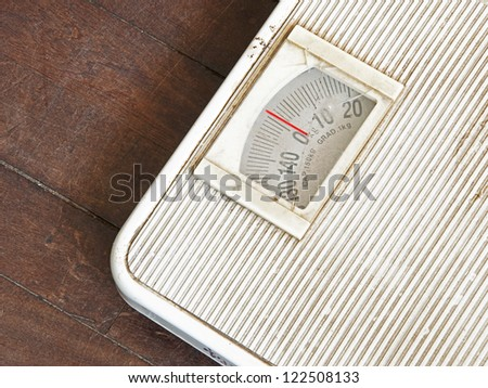Old Weighting Apparatus, Weighing scales on wood floor. - stock photo