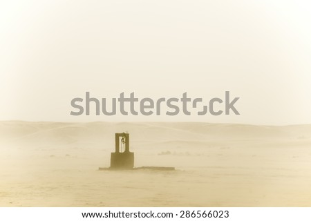 Old well in the middle of the desert, Moroccan Sahara - stock photo