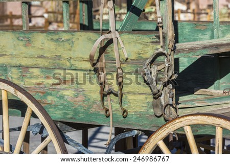 Old West background, Green buckboard wagon with Bridle  - stock photo