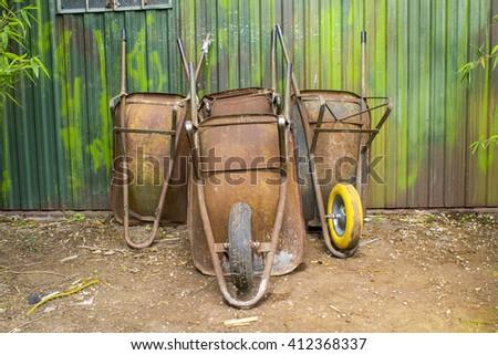 old wheelbarrows - stock photo