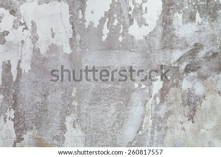 Old white concrete wall. Paint peeling off the walls. - stock photo
