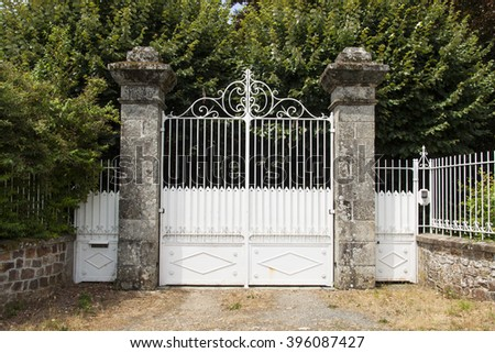 Old white double entrance made of stone and metal - stock photo