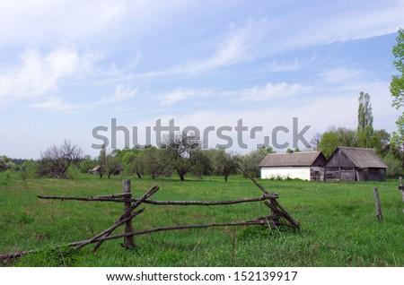 Old white house in ukraine village - stock photo