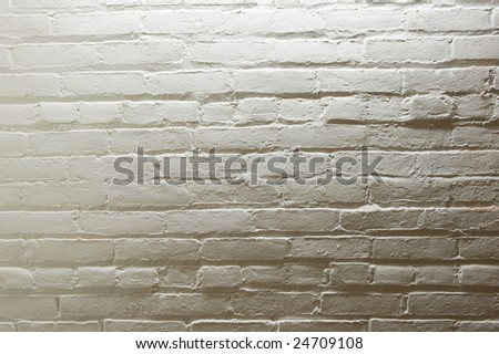 Old white painted brick wall. - stock photo
