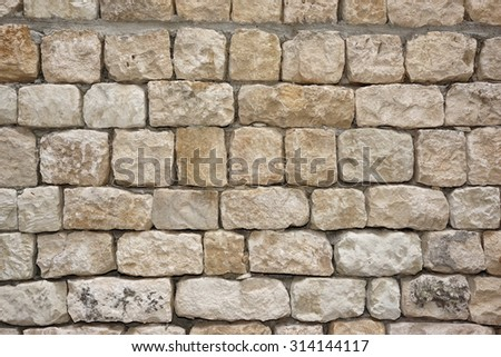 Old White Stone Wall Closeup Background Texture With Copy Space - stock photo