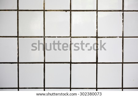 Old white tile on the concrete wall - stock photo