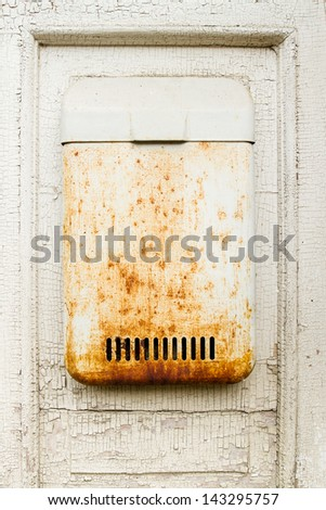 Old white wall with mailbox - stock photo