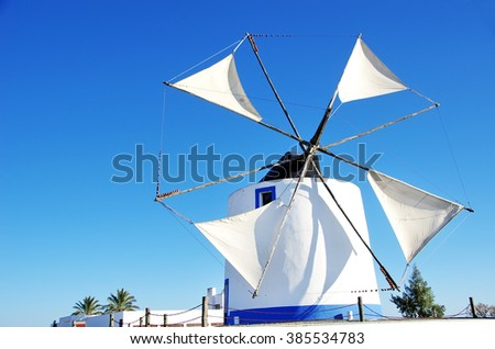 old white windmille at south of Portugal - stock photo
