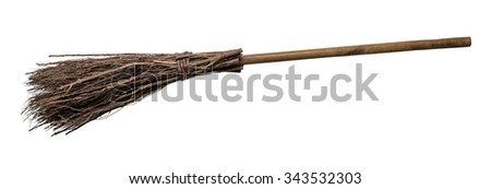 Old wicked witches broomstick isolated on white background. - stock photo
