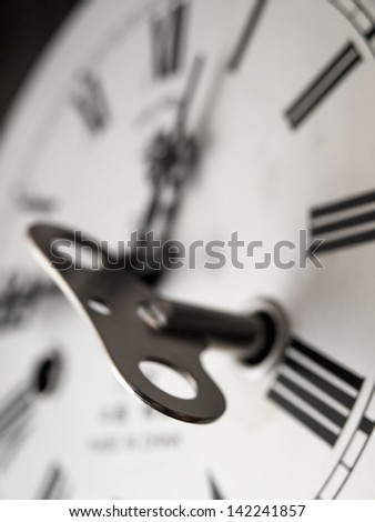 Old winding clock, closeup, for time related themes - stock photo