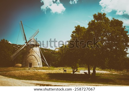 Old windmill in hungary - stock photo