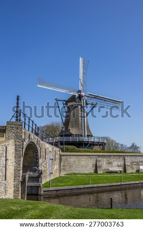 Old windmill in the historical city of Sloten, Netherlands - stock photo