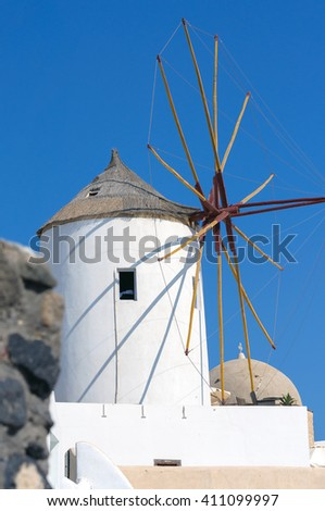 Old windmill of Oia town at sunny day, Santorini island, Greece - stock photo