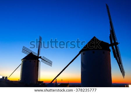 Old windmills on land of Spain. Located in the town of Campo de Criptana, where Don Quixote mistakes windmills for giants, in the book of Miguel de Cervantes. Spain - stock photo