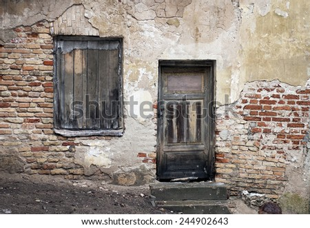 Old window and door with on obsolete grunge cracked wall  - stock photo