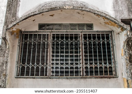 old window and iron cage - stock photo