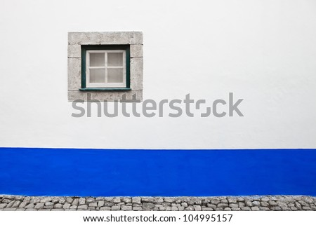 old window and white wall in portuguese village - stock photo