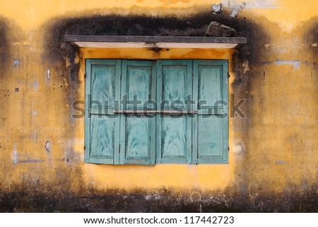 Old window at an abandoned dilapidated house. - stock photo