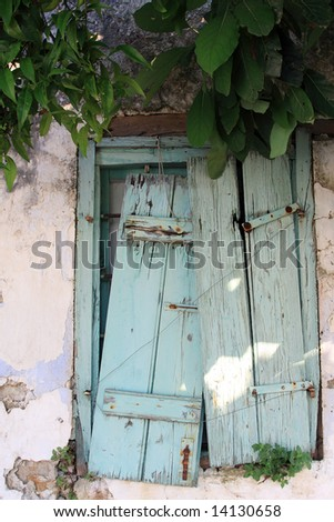 Old window in Greece - stock photo