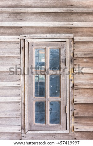 Old window in wooden cottage, classic house - stock photo