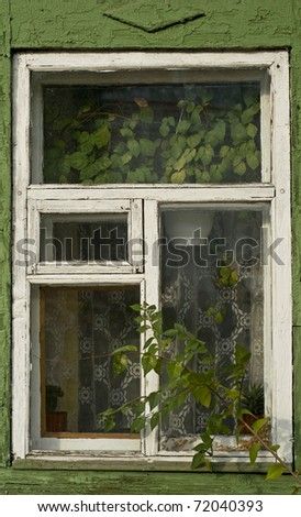 Old window on a cottage - stock photo