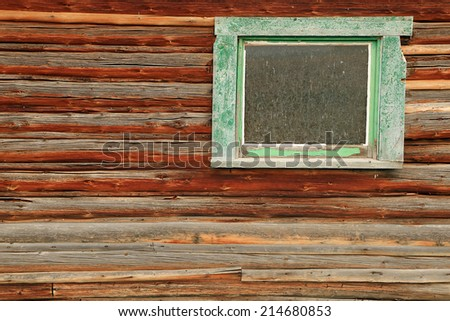 Old window on a wooden barn. - stock photo