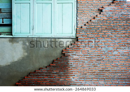 Old window on cracked concrete vintage wall backgroundold wall in thailand - stock photo