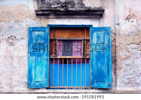 Old window on the old wall - stock photo