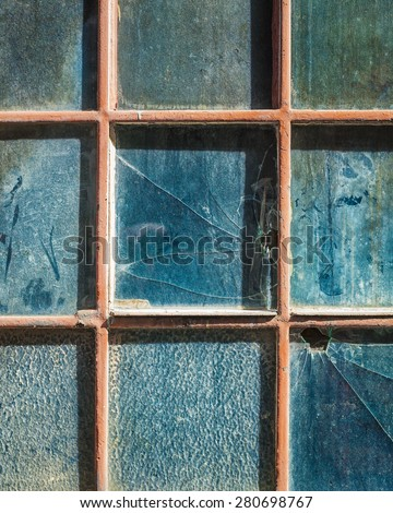 Old window with broken glass as background or frame - stock photo