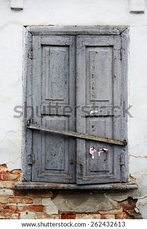 old window with gray shutters - stock photo