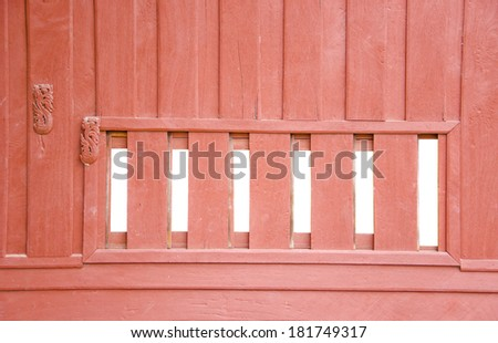 Old window with wooden shutters on wooden wall  in the countryside - stock photo