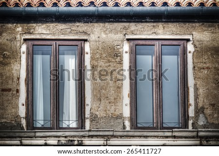 old windows in a grunge wall. Shot in Venice, Italy - stock photo