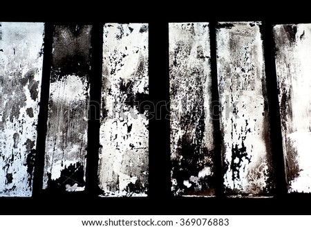 Old windows on an abandoned ironwork creating a nice background - stock photo