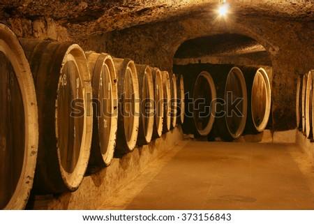 Old wine barrels in a wine cellar - stock photo