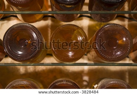 Old wine bottle in a cellar - stock photo
