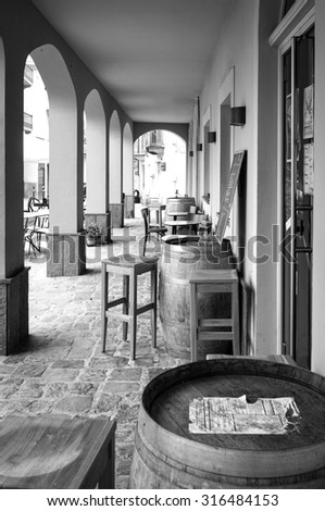 Old wine shop outside, in a little village of the winery region of Langhe (piedmont, Northern Italy). - stock photo