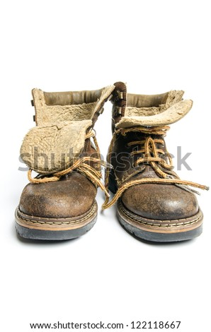 old winter and mountain boots on white background - stock photo