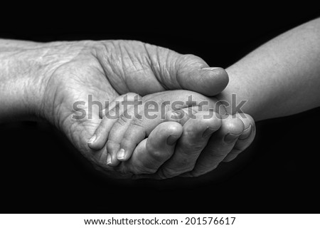Old woman and baby hands  - stock photo